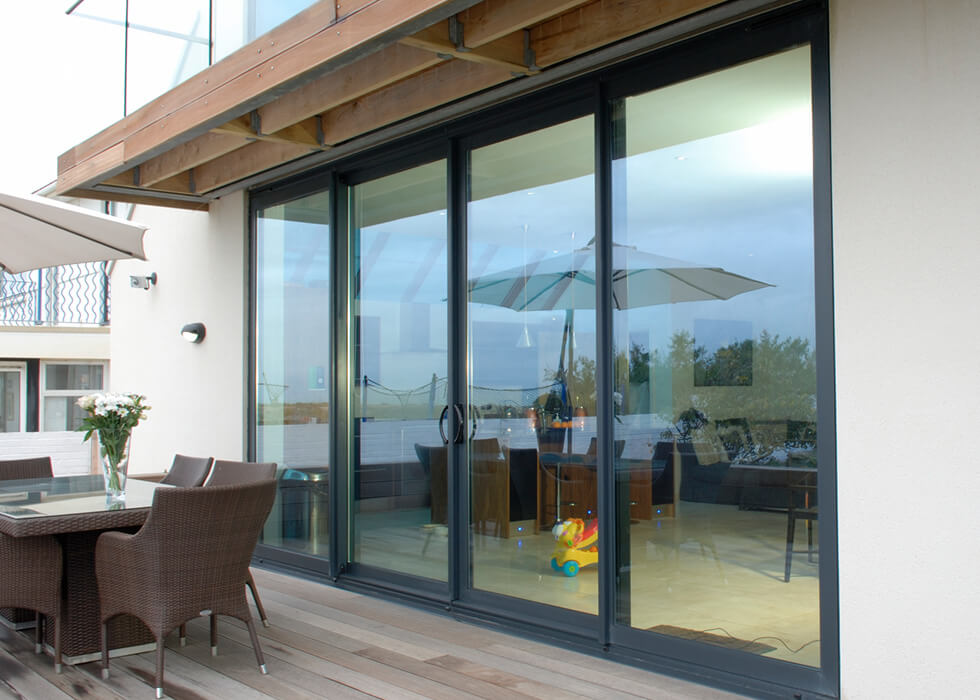 https://www.stedek.co.uk/wp-content/uploads/2018/04/Aluminium-patio-doors.jpg