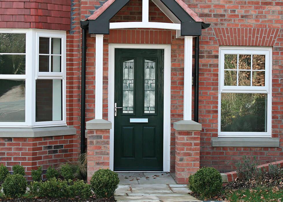 https://www.stedek.co.uk/wp-content/uploads/2018/04/Black-Solidor-composite-door.jpg