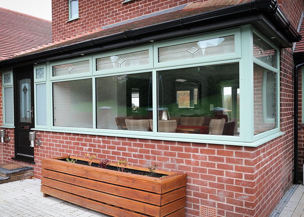 https://www.stedek.co.uk/wp-content/uploads/2018/04/Chartwell-green-uPVC-bay-window.jpg