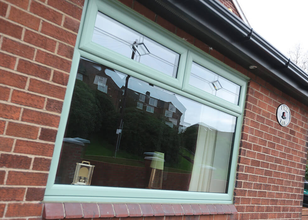 https://www.stedek.co.uk/wp-content/uploads/2018/04/Chartwell-green-uPVC-casement-window.jpg