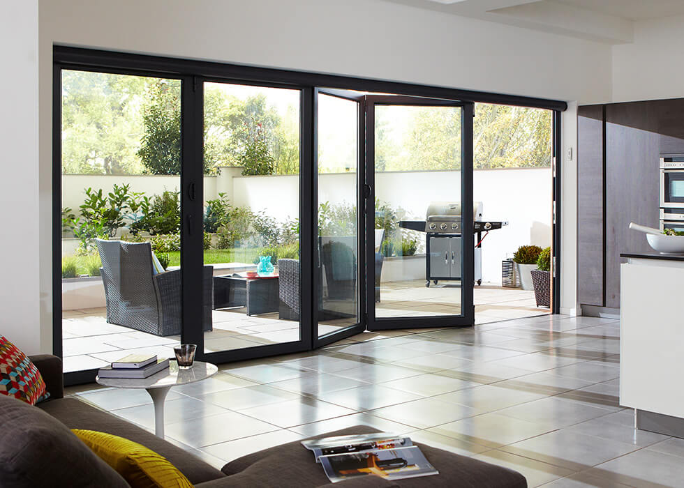 https://www.stedek.co.uk/wp-content/uploads/2018/04/Kitchen-aluminium-bifold-door.jpg