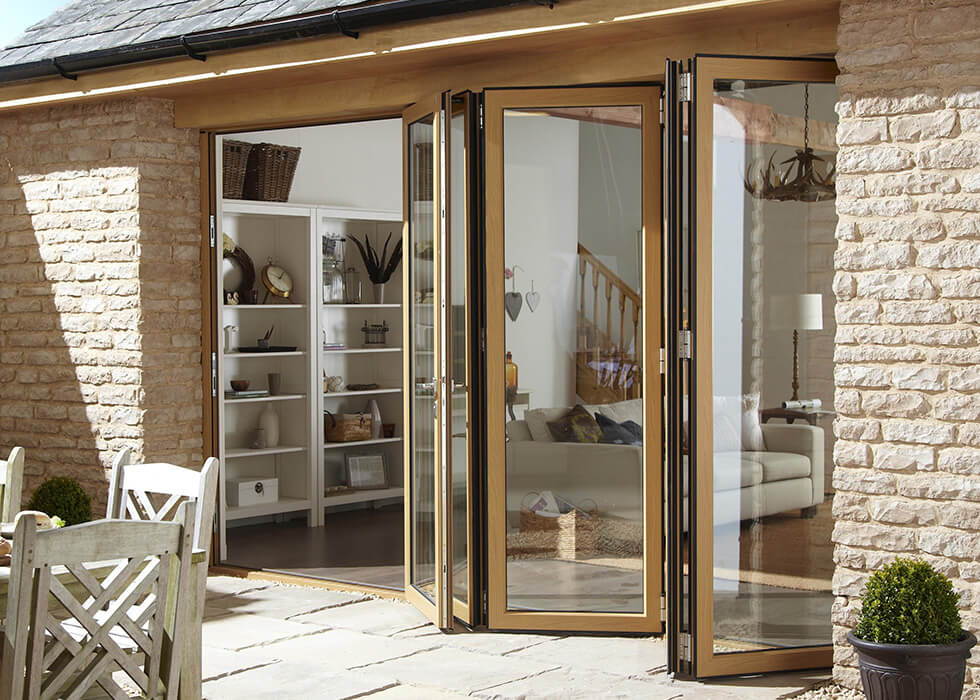 https://www.stedek.co.uk/wp-content/uploads/2018/04/Oak-effect-aluminium-bifold-door.jpg