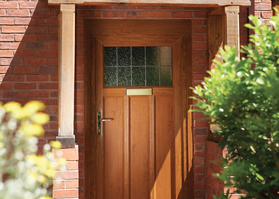 https://www.stedek.co.uk/wp-content/uploads/2018/04/Oak-effect-uPVC-entrance-door.jpg