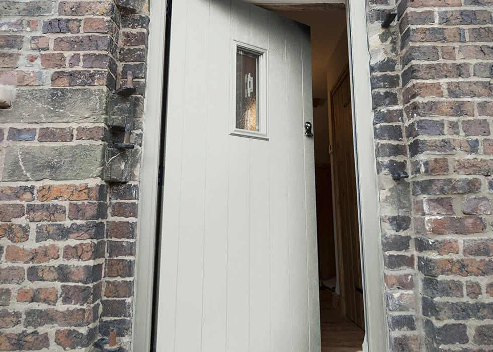 https://www.stedek.co.uk/wp-content/uploads/2018/04/Painswick-solidor-composite-door.jpg