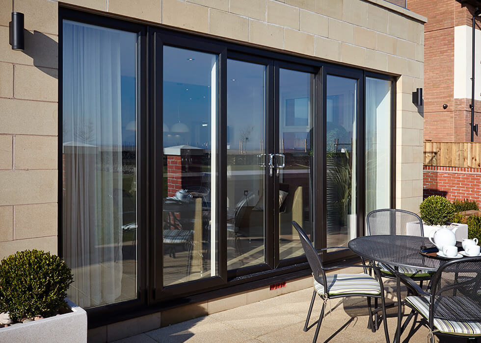 https://www.stedek.co.uk/wp-content/uploads/2018/04/Patio-Master-black-sliding-door.jpg