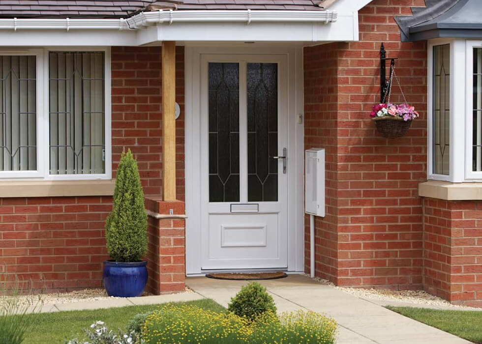 https://www.stedek.co.uk/wp-content/uploads/2018/04/uPVC-entrance-door-with-silver-hardware.jpg